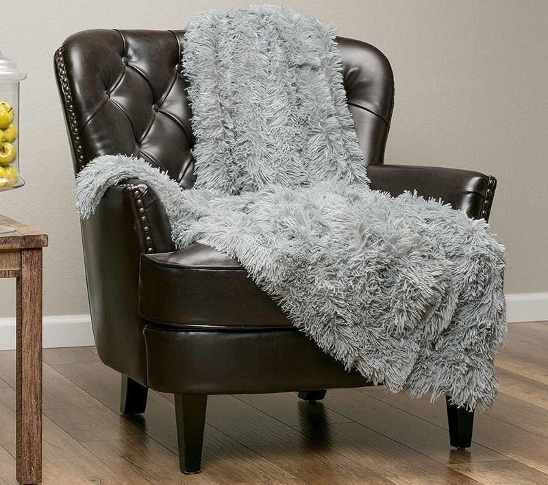 A light gray shag blanket thrown over a chair