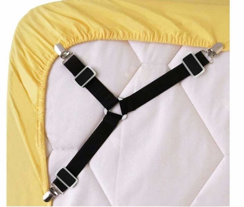 The bed sheet clips keep a sheet clipped down on a mattress