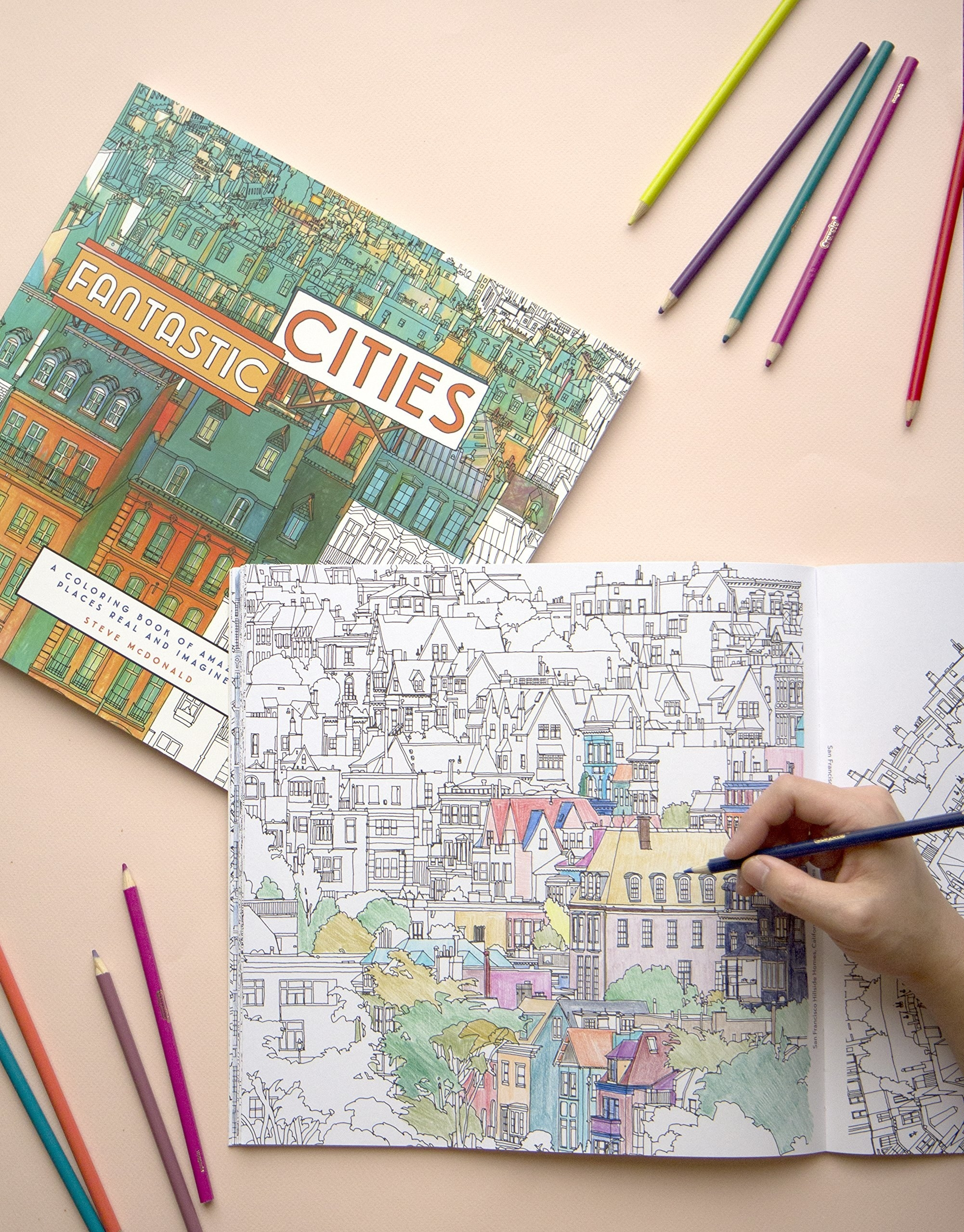 Someone coloring in the Fantastic Cities coloring book.
