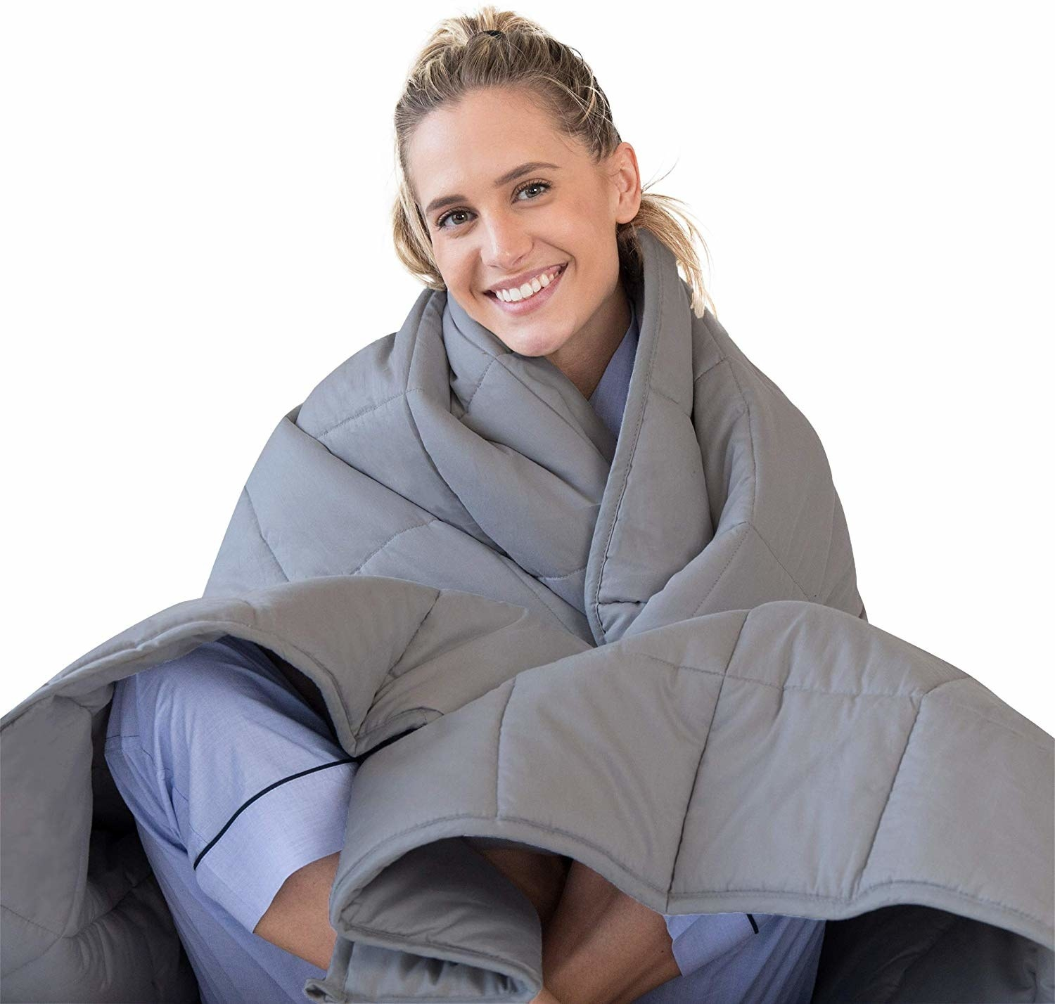 A model wearing the blanket around themselves