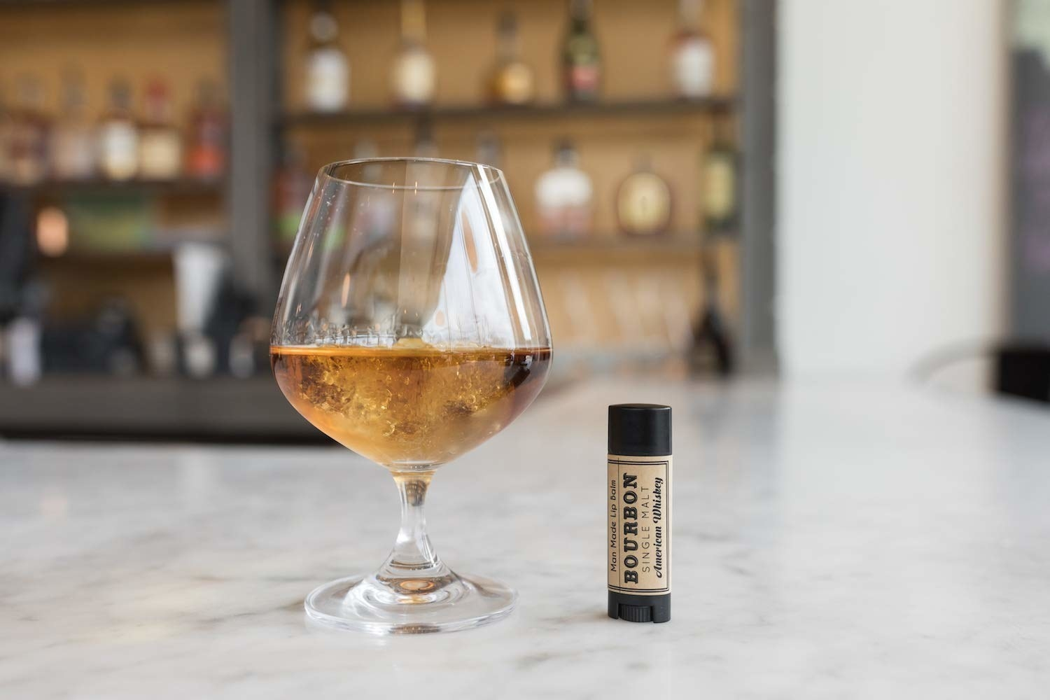 The bourbon lip balm.
