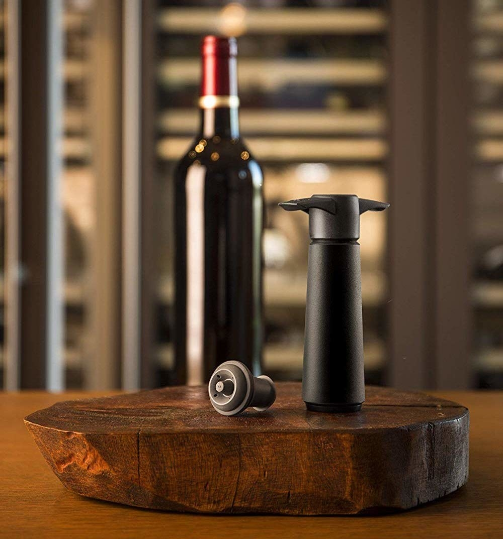 The wine saver in front of a bottle of wine