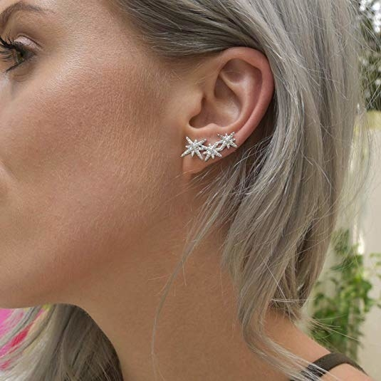 a trio of starry crawler earring
