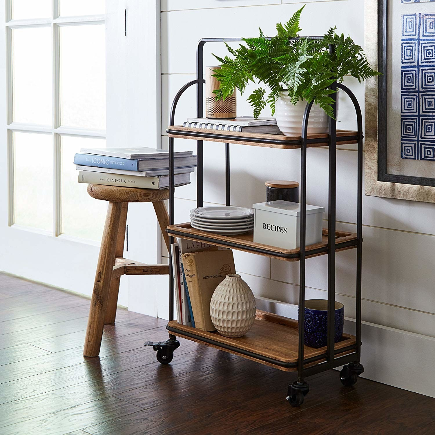 The wooden kitchen cart, featuring three shelves and matte black hardware