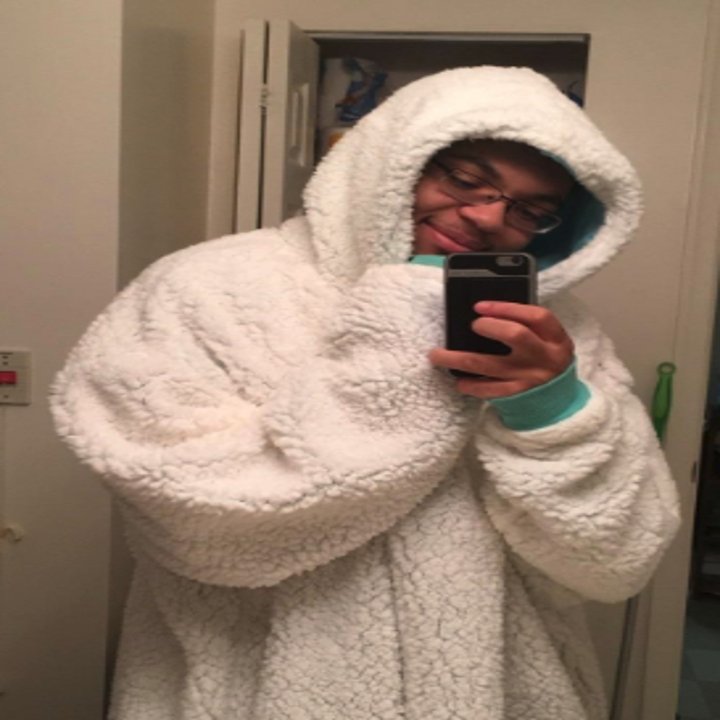 a reviewer wearing the snuggly blanket sweatshirt in white