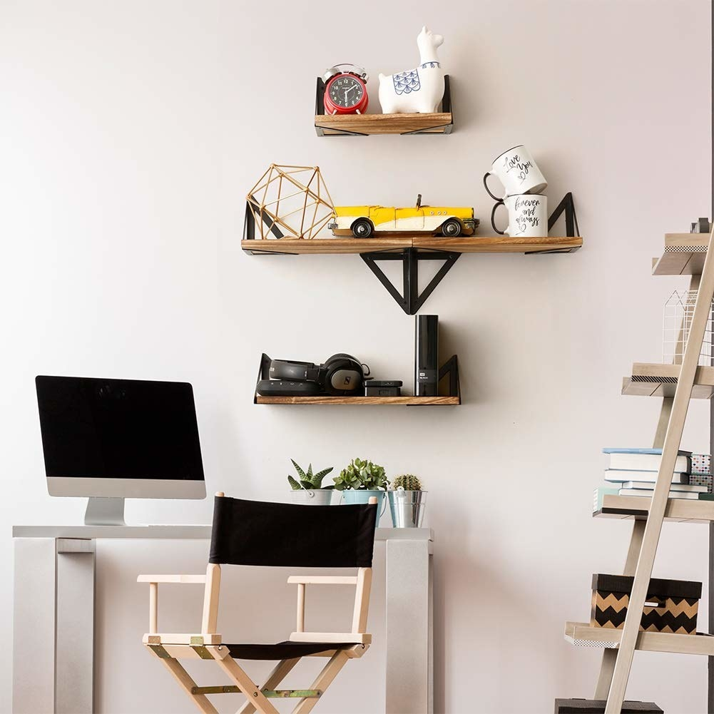 The wooden shelves mounted on the wall