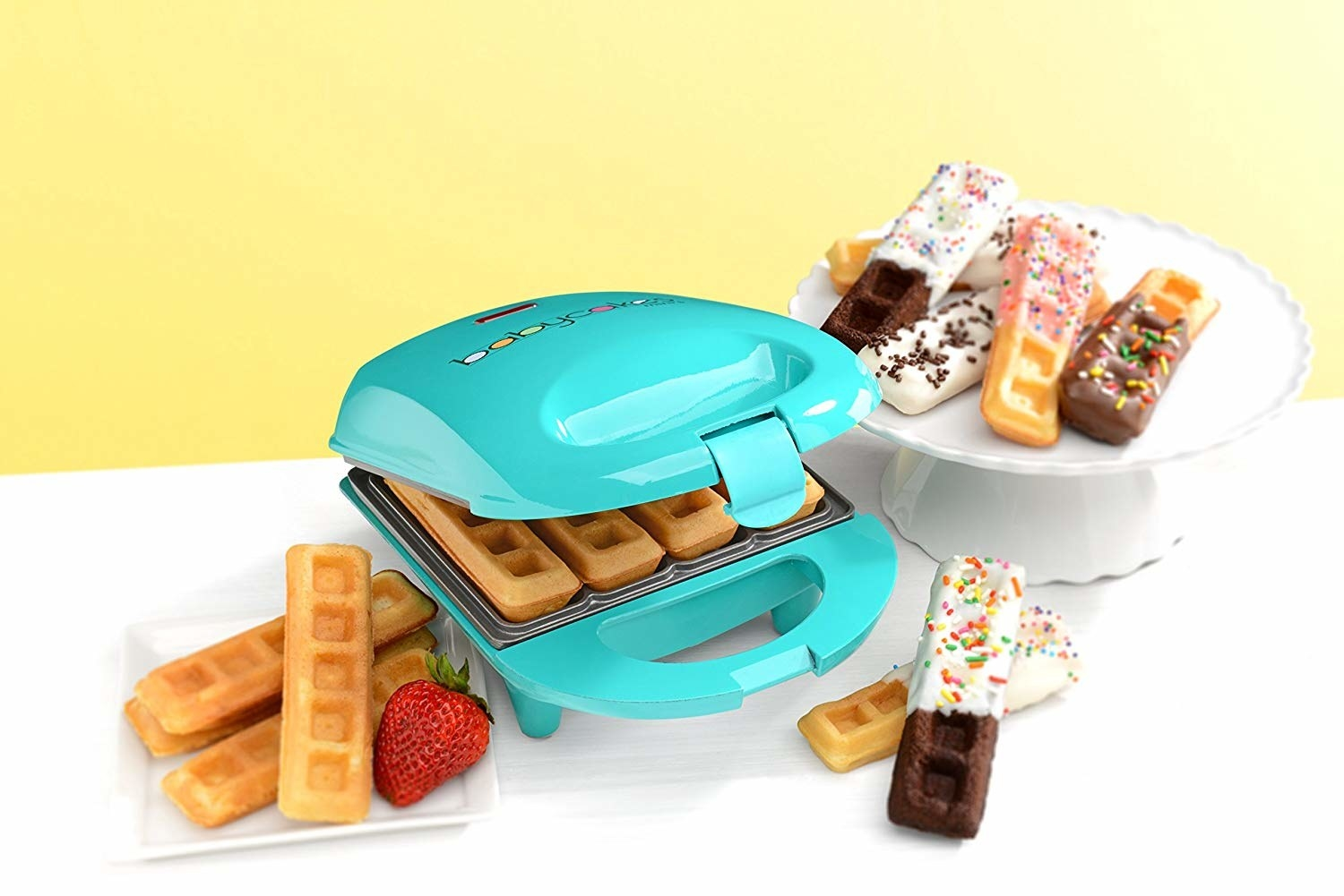 a small dome-like waffle stick maker in teal blue