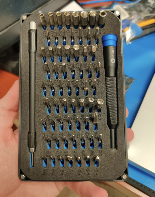 a reviewer holding a fix it kit
