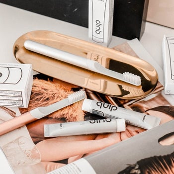 the toothbrushes in white and rose gold