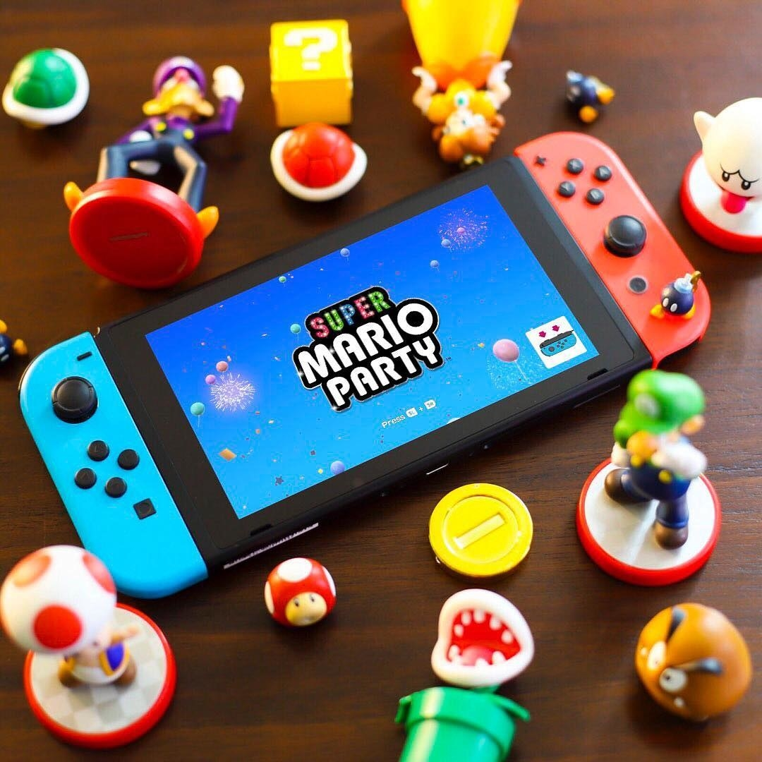 The Switch surrounded by Mario figurines