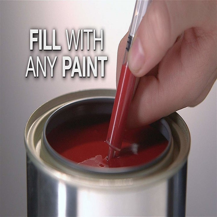a person filling the paint pet with red paint