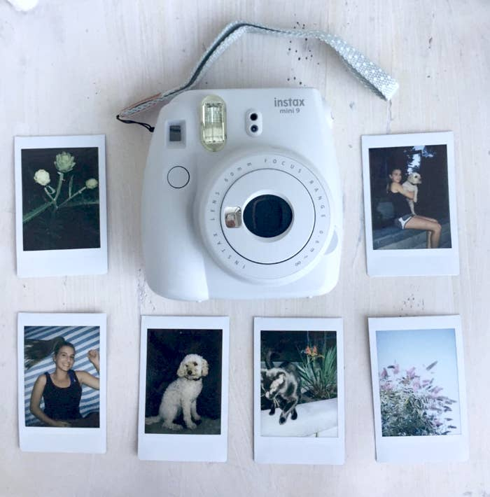 Reviewer image of Instax camera and photos surrounding it they took