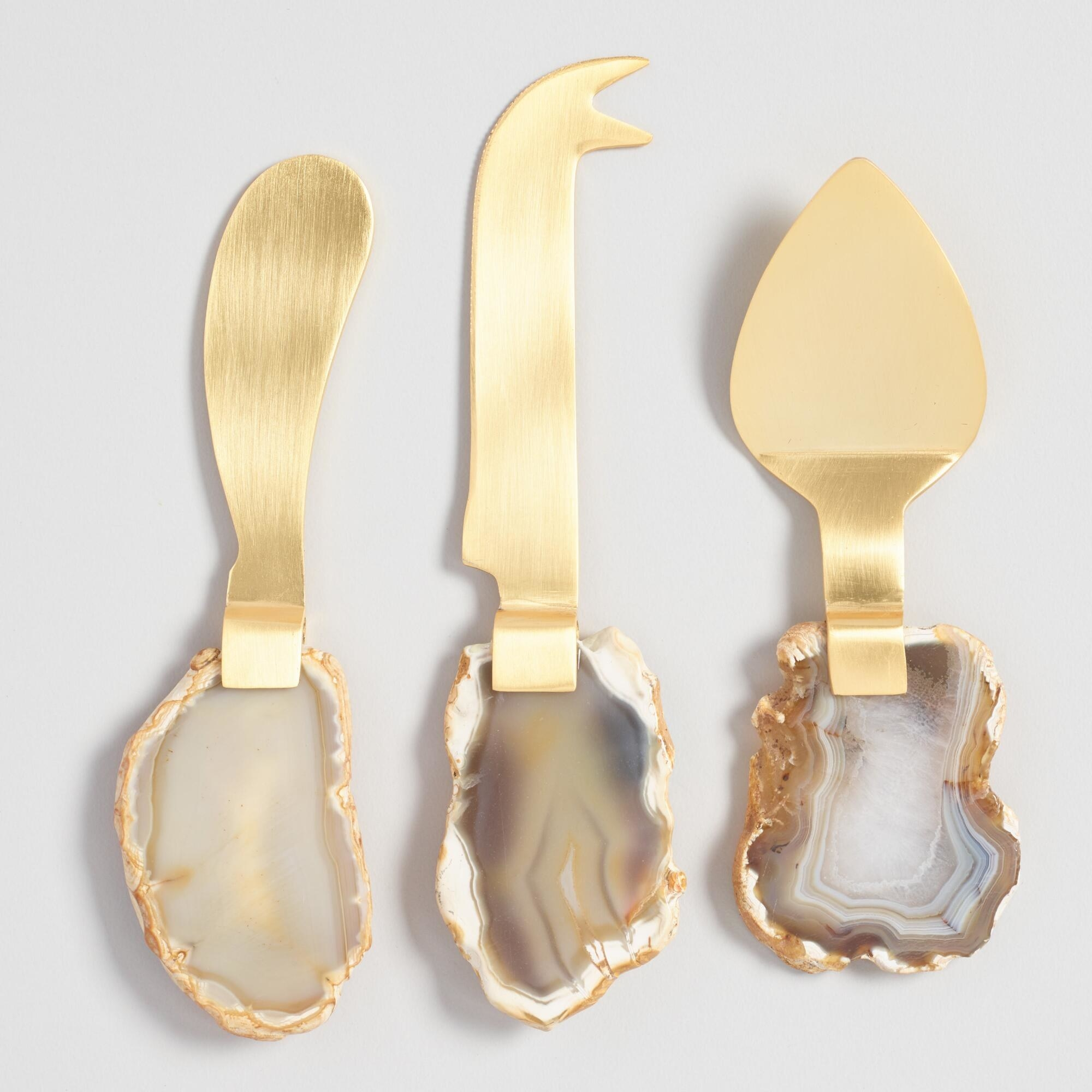 The utensils with brown-grey-gold agates as handles