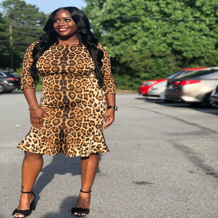 Reviewer wearing the knee-length bodycon dress in brown leopard print