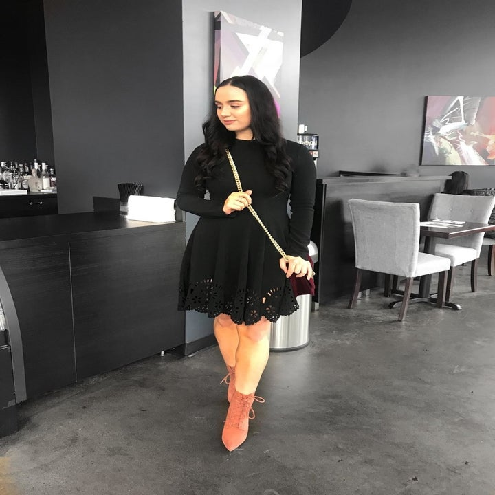 Reviewer wearing the long-sleeved dress in black