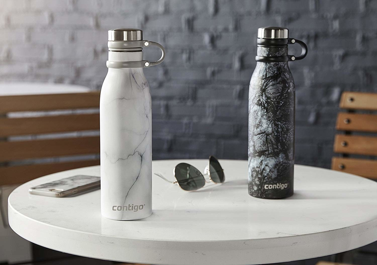 Two of the bottles with attached tops (on a loop to keep them handy) in white marble and black marble prints