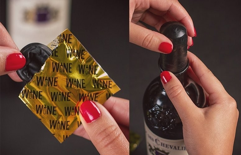 A model pulling the circular, black condom-like topper from the packaging and putting it over the top of a wine bottle