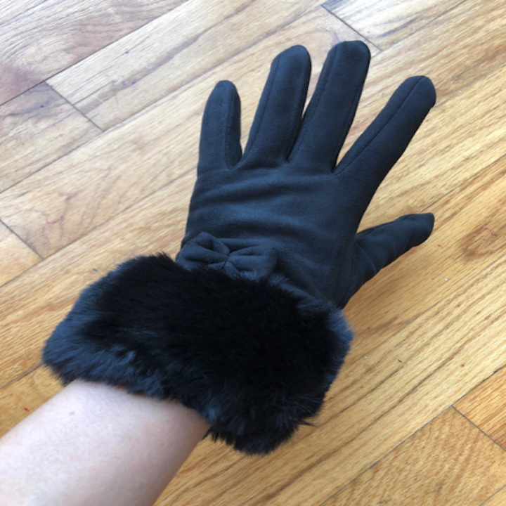 reviewer's hand with the glove on in black