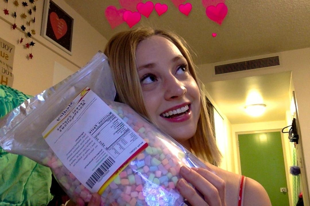 Reviewer with the bag of cereal marshmallows