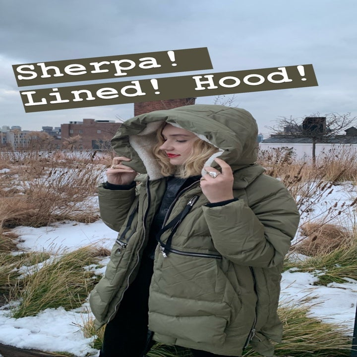"Writer wearing the coat with the hood up, caption ""Sherpa! Lined! Hood!"""