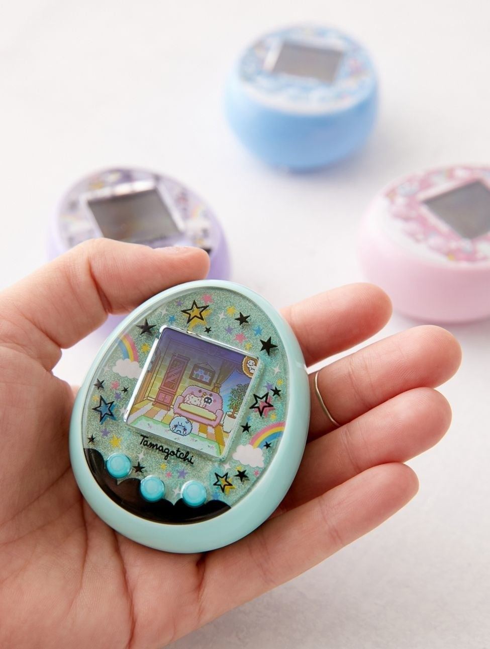 the tamagotchi on in the color magic green