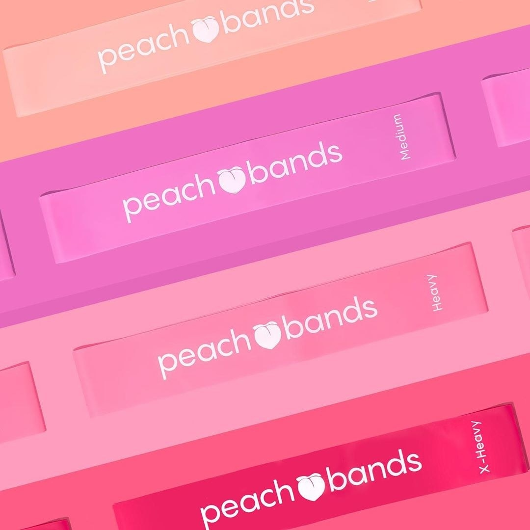 The bands arranged on a colourful background