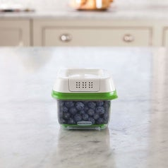 produce container with blueberries in it