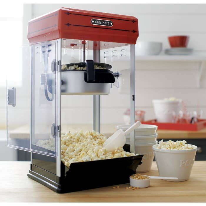 The popcorn maker filled with popcorn