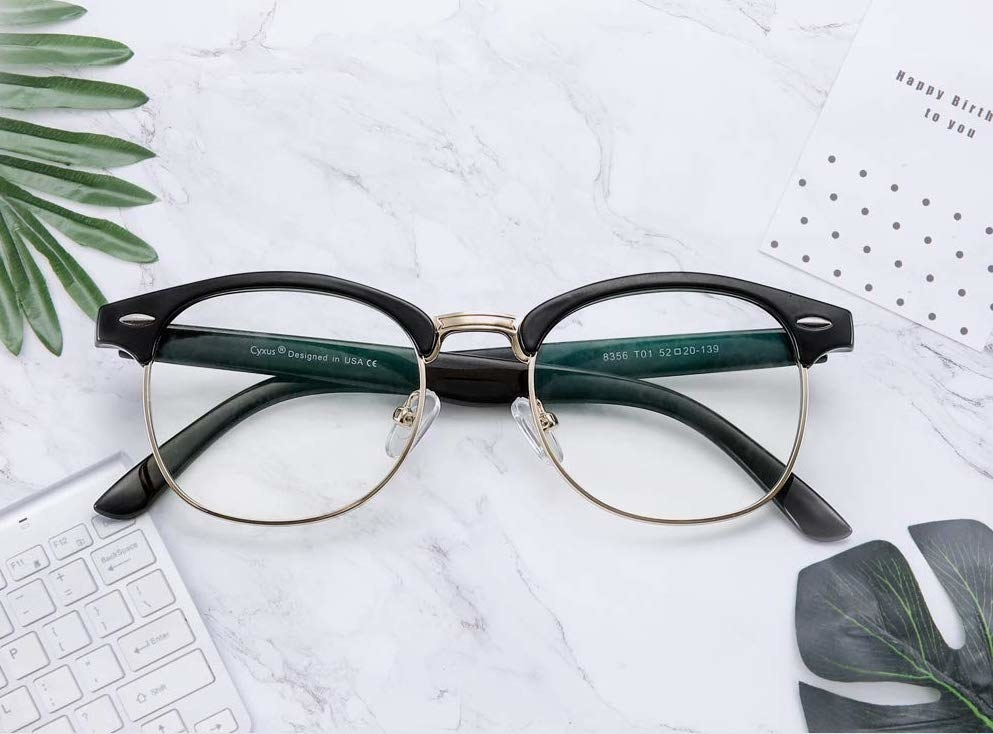 A pair of glasses on a marble countertop