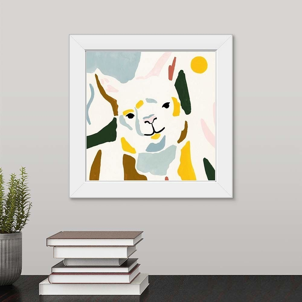 The square print illustration of a llama with color patches of blue, green, yellow, and brown