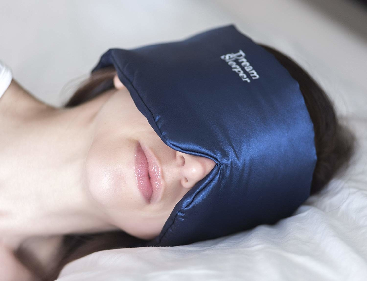 A person sleeping with the mask on their face