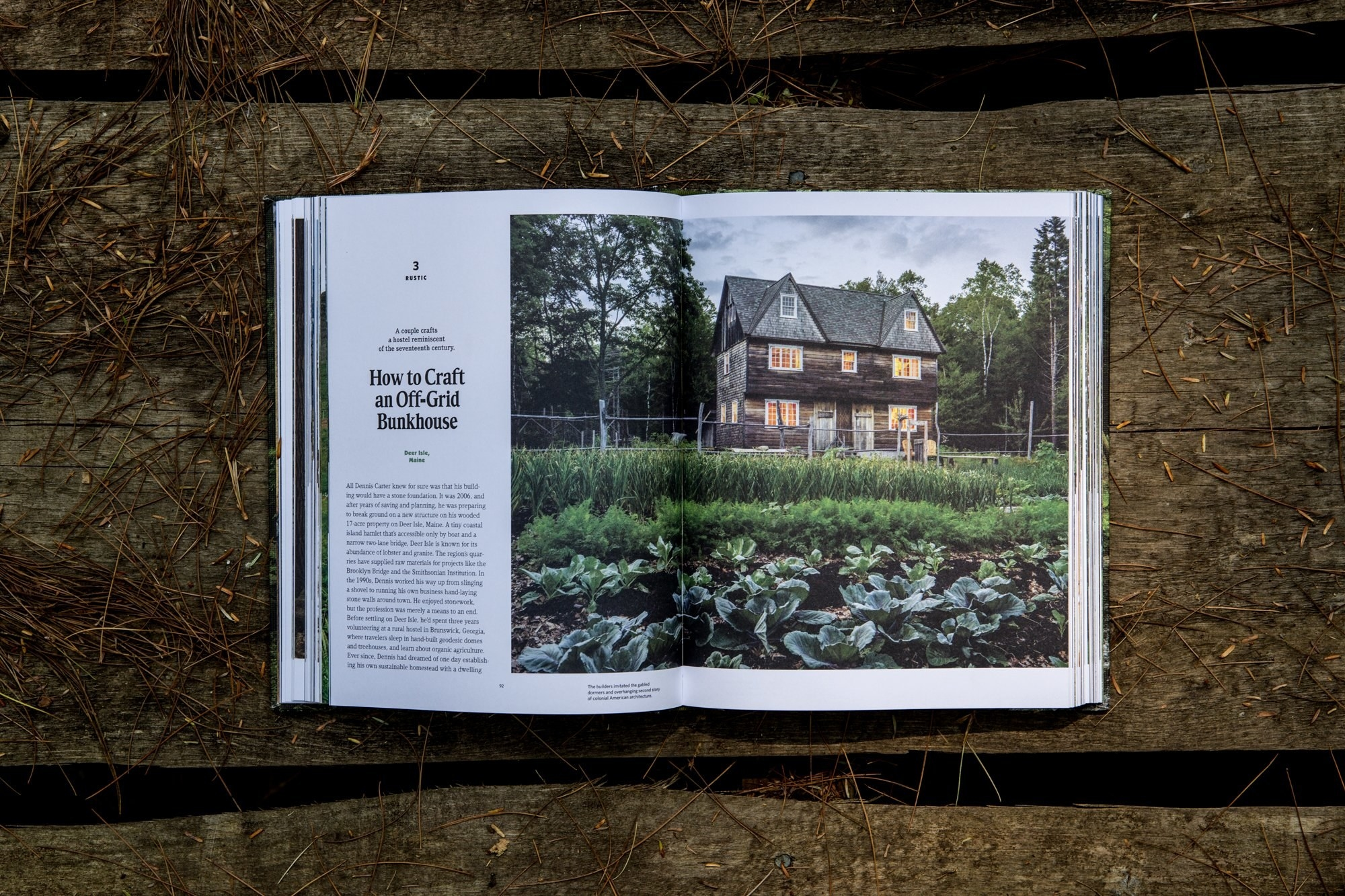 The book open to a page on how to craft an off-grid house