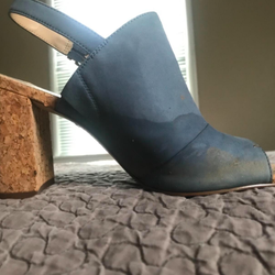 Blue heel with water stain at foot