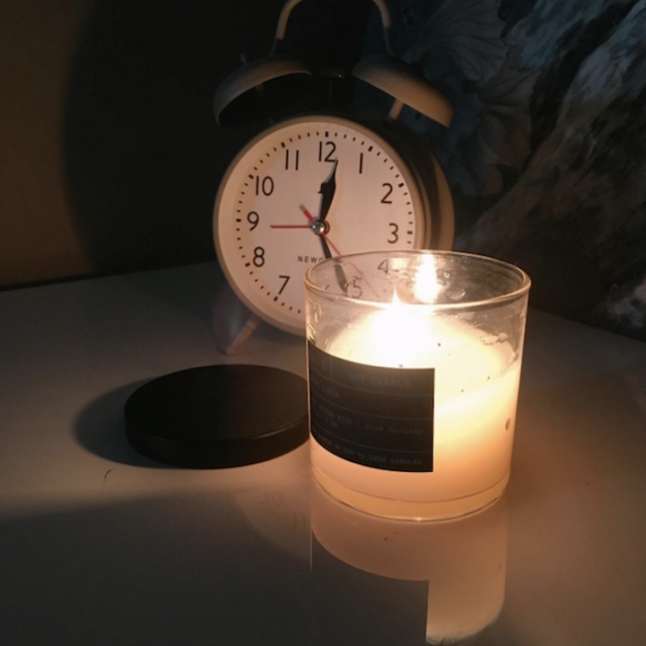 the candle with the top removed and lit up