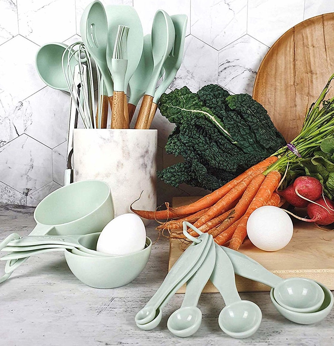 mint green kitchen utensils including measuring cups and spoons