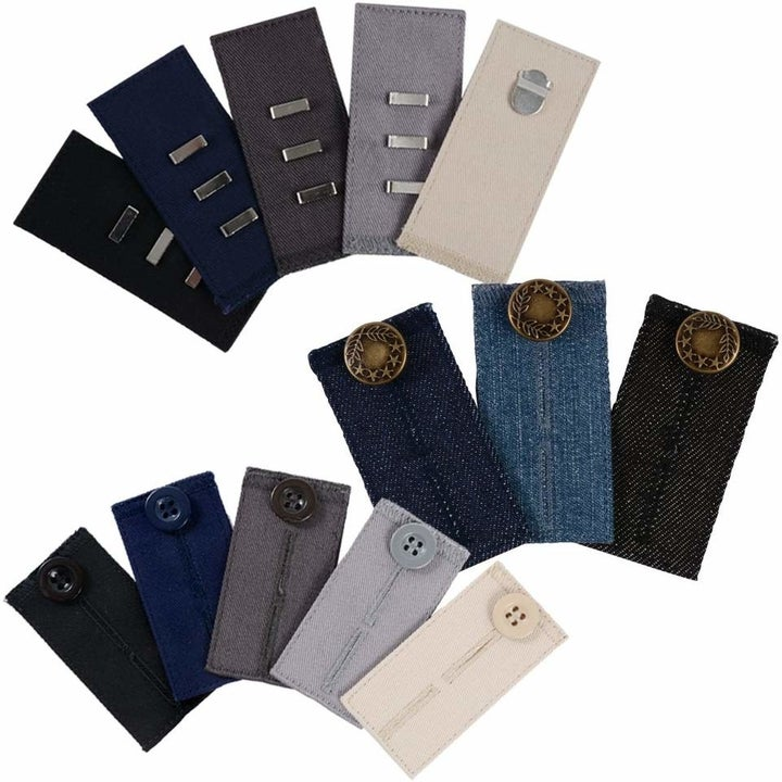 The extender tabs in black, navy, gray, light gray, cream, and three shades of denim with various hook and button closures