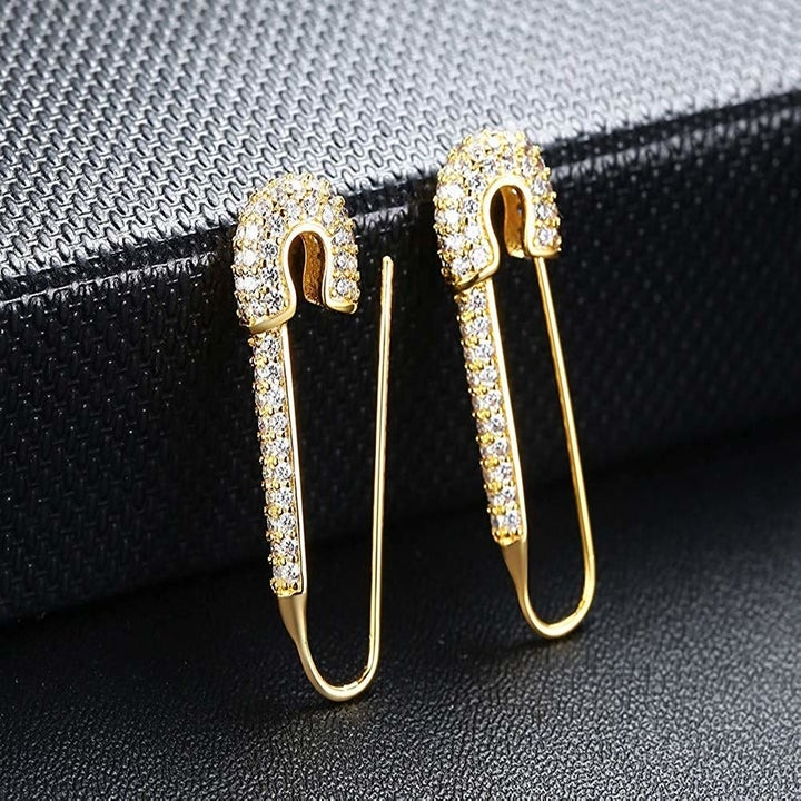the gold earrings