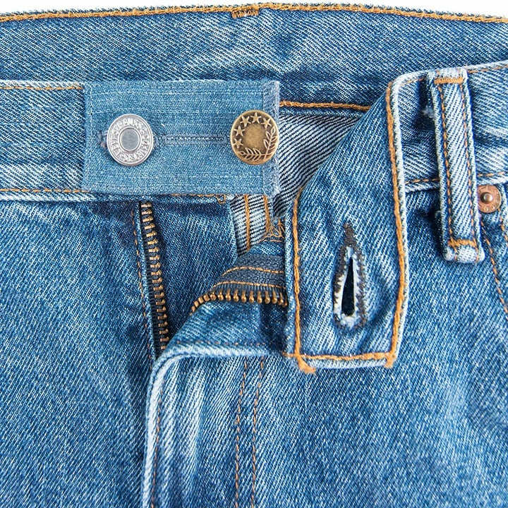 The blue denim one fastened to the waistband of a pair of jeans