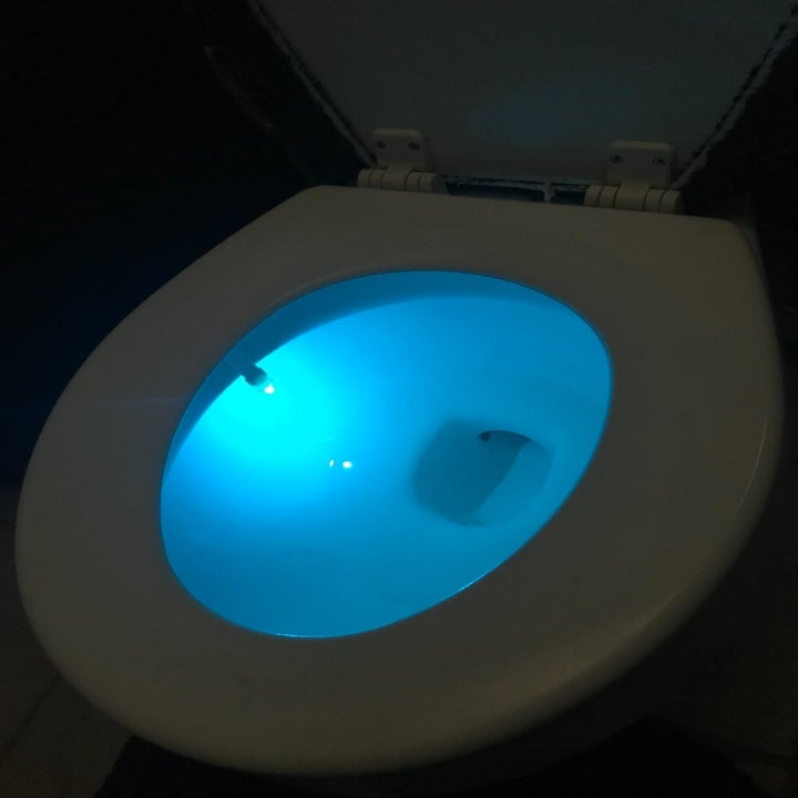 reviewers toilet bowl glowing blue