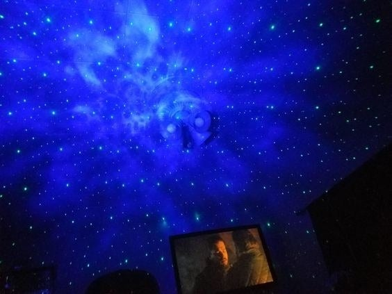 reviewer photo of the blue stars and night sky from the projector