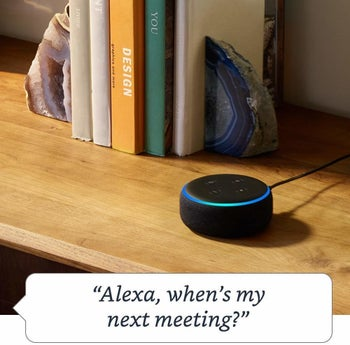 the echo dot in black with a speech bubble that says