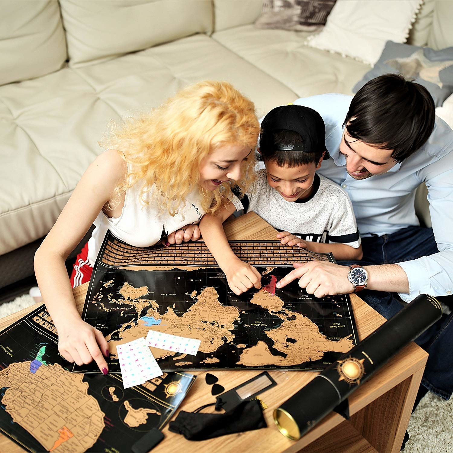 A family scratching off the gold map on a black background