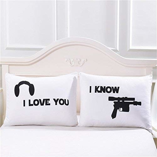 "The two pillowcases: one that says I love you with princess leia's hairstyle, the other with ""I know"" and a blaster"