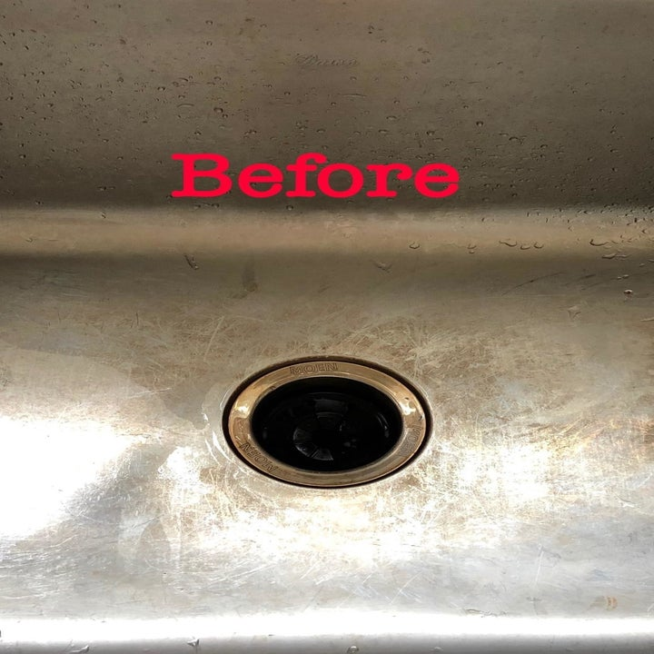 "A reviewer's stainless steel sink with staining and the word ""before"""