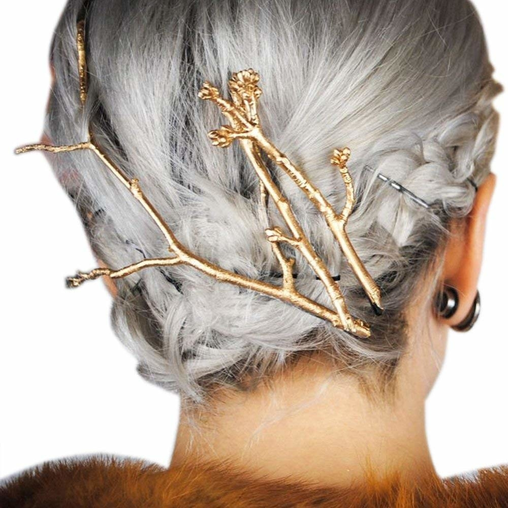 The three-piece tree branch hairpins in someone's hair.