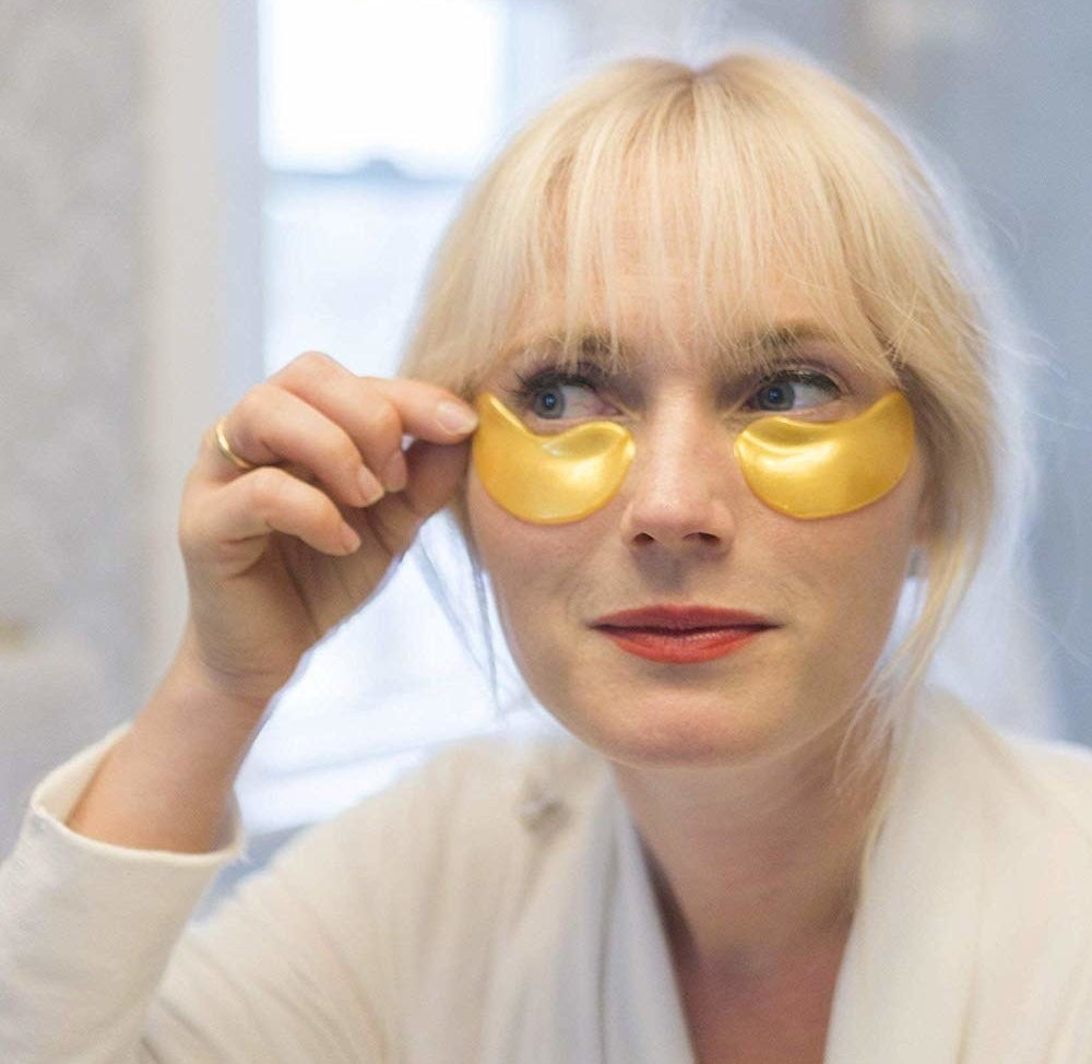 Model with the gold undereye masks on