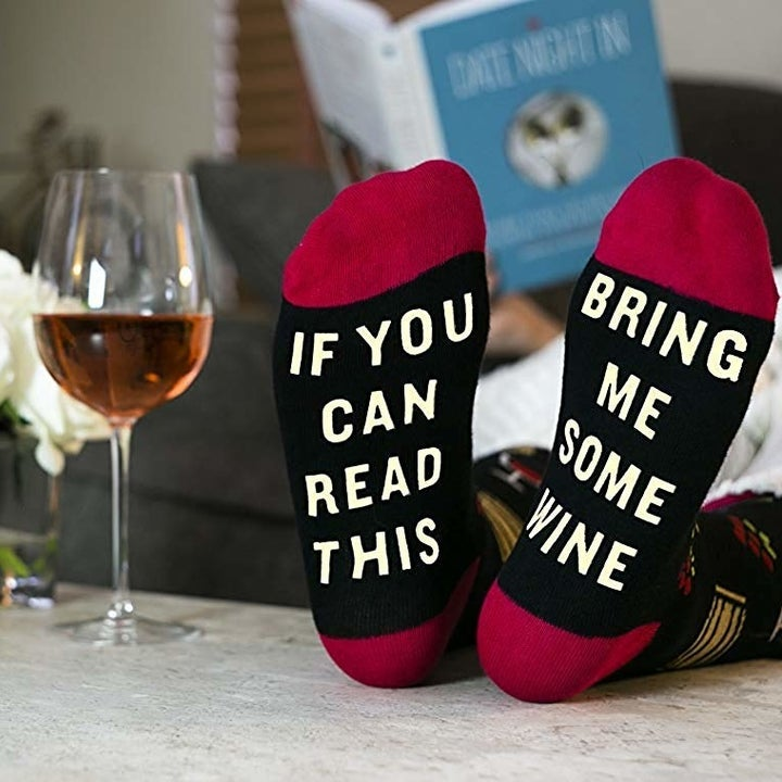 "in the bottom, the socks read, ""If you can read this bring me some wine"""
