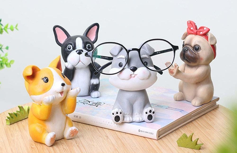 four puppy statues that can hold glasses