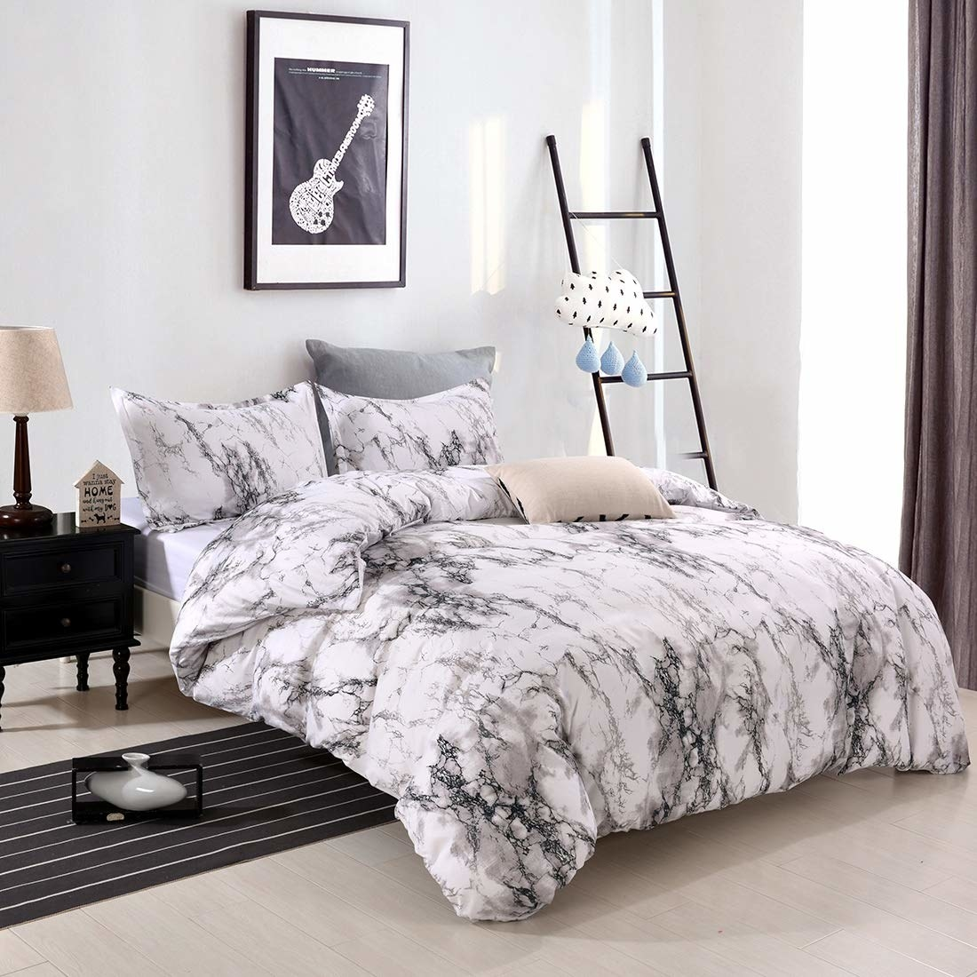 A thick duvet on a bed with tons of pillows