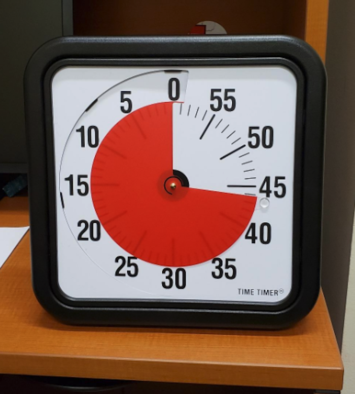 a timer that has the style of clock but instead of all 12 hours of the day, it has numbers 0 to 55 to count up to an hour. As the clock arms move forward, the time that's already passed is red.
